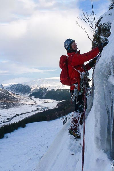 Dave Broadhead on the first ascent of Gift Horse (IV,5) on Meall Bhuidhe in Strathconon. Loch Beannacharain is just off picture to the left and the head of Strathconon is in the background. (Photo John Mackenzie)