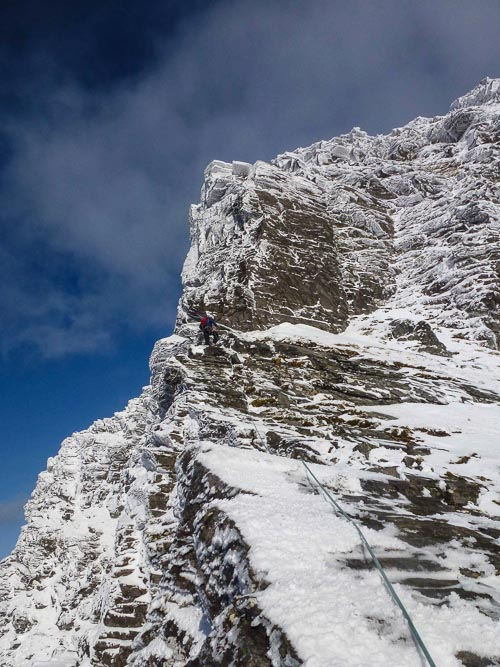 Steve Perry below the Tower during the first winter ascent of the 470m-long Tower Ridge (V,6) on the North-West Face of Ben Hope. The face was first explored by Jim Bell in 1933. (Photo Andy Nisbet)