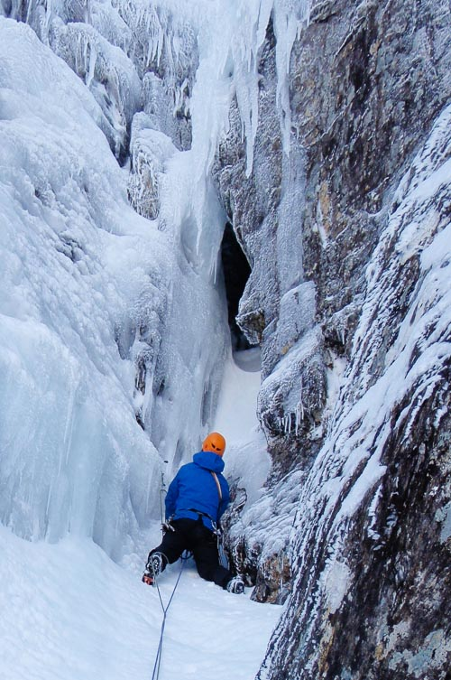 Simon Richardson approaching the through-route of Time Lords (VI,6) on the North Face of Aonach Beag. Surprisingly the tunnel shaped feature was entirely composed of ice and not based on an underlying chokstome. (Photo Roger Webb)