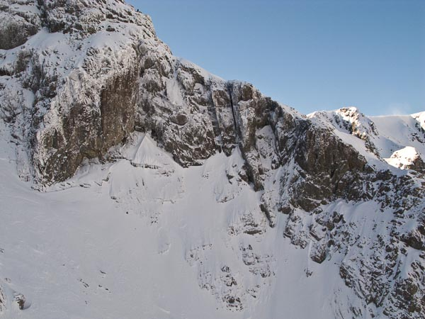 The line of Red Dragon (VIII,9) on the East Face of Tower Ridge on Ben Nevis. The deep gash just right of centre is The Great Chimney (V,6) that was first climbed in winter by Jimmy Marshall and Robin Smith during their famous week in February 1960 when they climbed six new routes culminating in the first ascent of Orion Direct. (Topo Dave MacLeod/Archive Photo Simon Richardson)