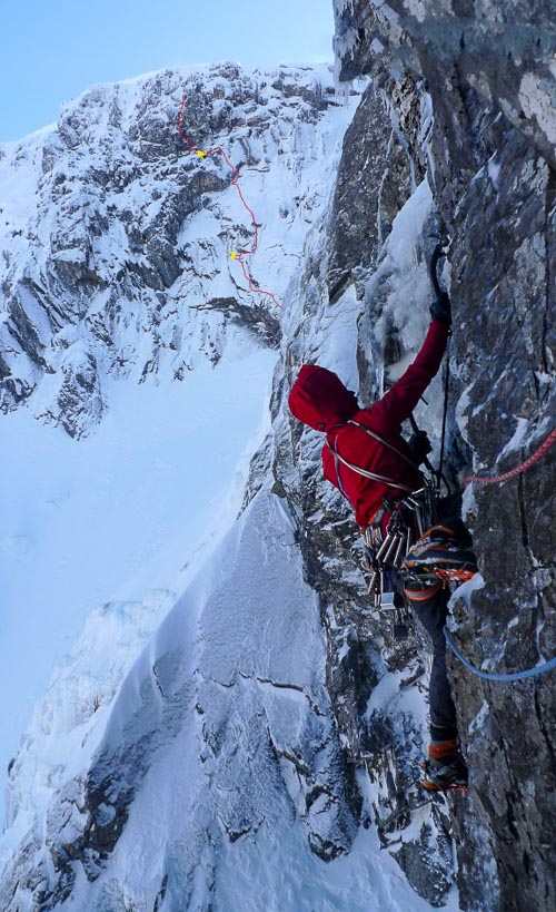 Uisdean Hawthorn climbing Clefthanger (VII,7) on the East Flank of Tower Ridge with Indicator Wall in the background. The line of Call Me Ishmael (VIII,9) is marked in red. (Photo Iain Small)