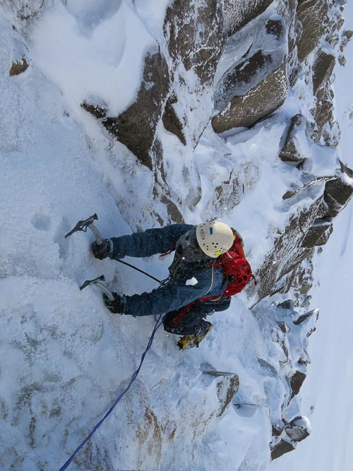 Tim Chappell enjoying excellent icy conditions on the first ascent of Anzac Day (IV,4) in Coire Ruadh on Braeriach. The route was climbed on April 25 and is one of a number of high-altitude Cairngorms new routes climbed this spring. Tim's retro headgear was put to good use battling the punishing spindrift! (Photo Simon Richardson)