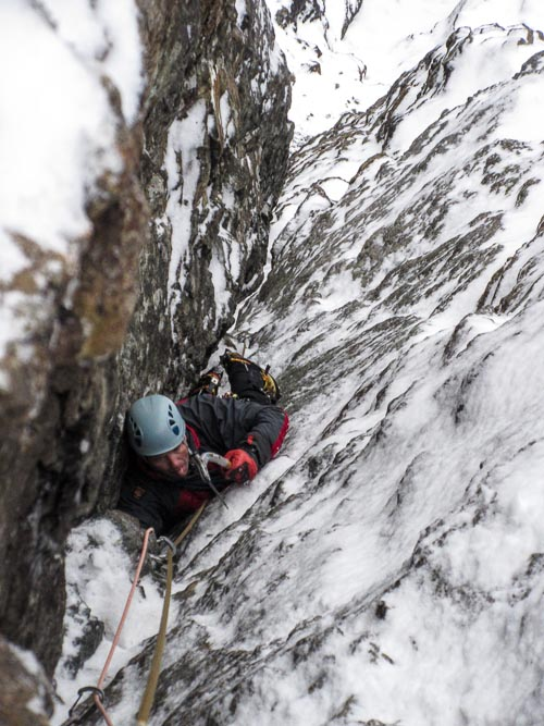 Murdo Nicholson following the initial pitch of The Breadline (V,5) during the first ascent. This 70m route lies on the North Face of Am Basteir on Skye. (Photo Mike Lates)