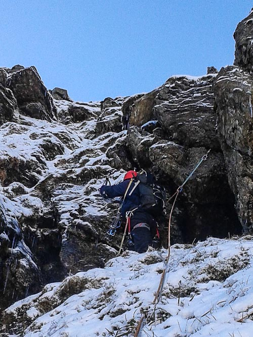 Gerhard Mors on the first ascent of Forked Gully Buttress (II/III) on Beinn Ime. The key to the route's success was lying in the shade of Fan Gully Buttress. (Photo Stephan Mors)
