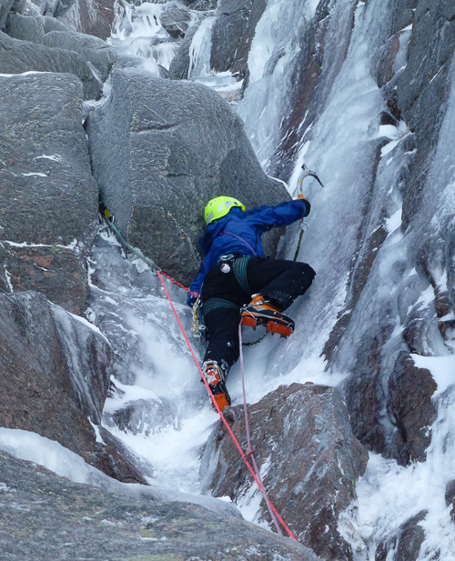 Steve Perry making the first ascent of Have an Ice Day (V,5) on Lurcher's Crag on Cairn Gorm. This was the first of a fine triptych of routes in the cliff. (Photo Andy Nisbet)