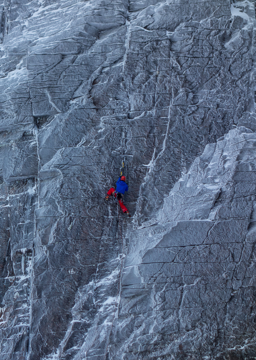 Andy Inglis styling up the third ascent of Pfugga-lule (VIII,9) on the impressive Happy Tyroleans wall on No. 3 Buttress in Coire an Lochain. This superb shot was taken by Dave Riley during an ascent of Savage Slit. (Photo Dave Riley).