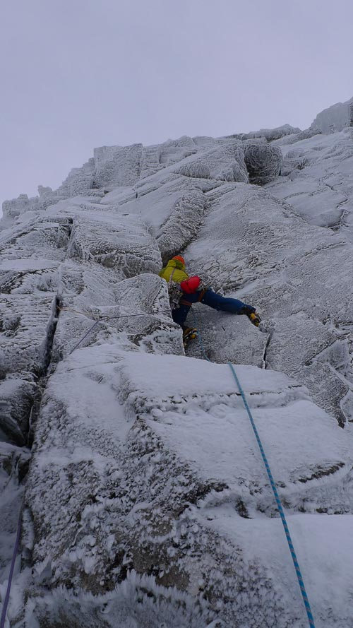 Uisdean Hawthorn doing battle with the fierce second pitch of Crusade (VII,8) during the second ascent. This steep line on Church Door Buttress was first climbed by visiting US climber Steve House with Sam Chinnery during the 2005 International Winter Meet. (Photo Iain Small)