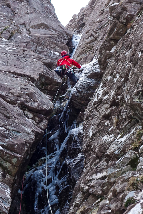 Helen Rennard on the first winter ascent of Buffalo Ballet on Creag nan Calman on Cul Mor. This Scottish VS was first climbed by R.Gatehouse and C.Smith in July 1979 and was the first recorded climb on the mountain. (Photo Simon Richardson)