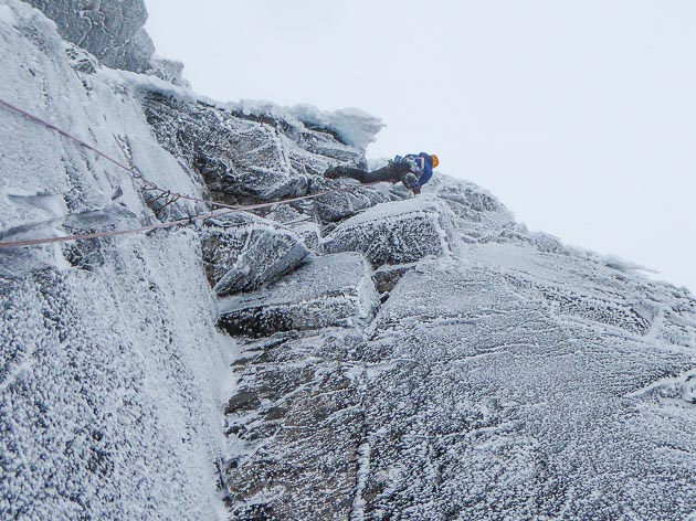Iain Small just reaching the hanging icicle on the crux pitch of Gates of Paradise (VIII,8) during the first ascent. This very steep route lies high up on the right side of Church Door Buttress in Glen Coe. (Photo Murdoch Jamieson)