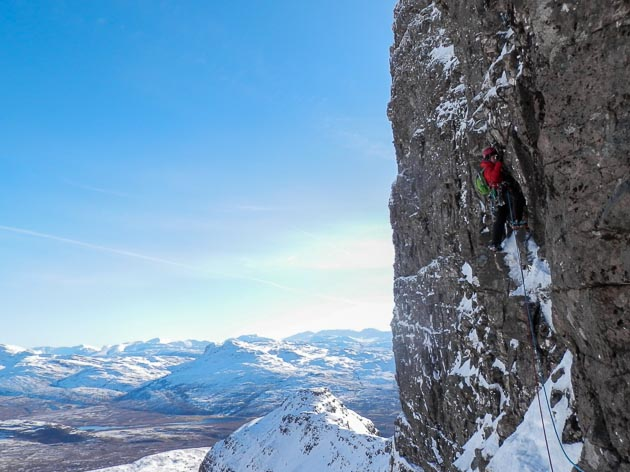 Helen Rennard leading pitch 2 of The Godfather (VIII,8) on Beinn Bhan. This touchstone route was first climbed by Martin Moran and Paul Tattersall in March 2002 and has become one of the most sought after high standard mixed routes in the Northern Highlands. (Photo Dave Almond)