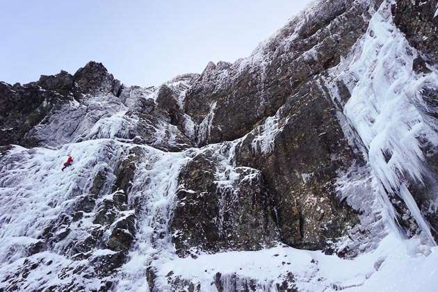 Uisdean Hawthorn climbing the first crux pitch of Spectacula (VI,6) on the North Face of Sgurr a'Mhadaidh during the first ascent. The line to the right is Spirulina (V,5) and Icicle Factory (VI,6) is on the far right of the picture. (Photo Adam Russell)