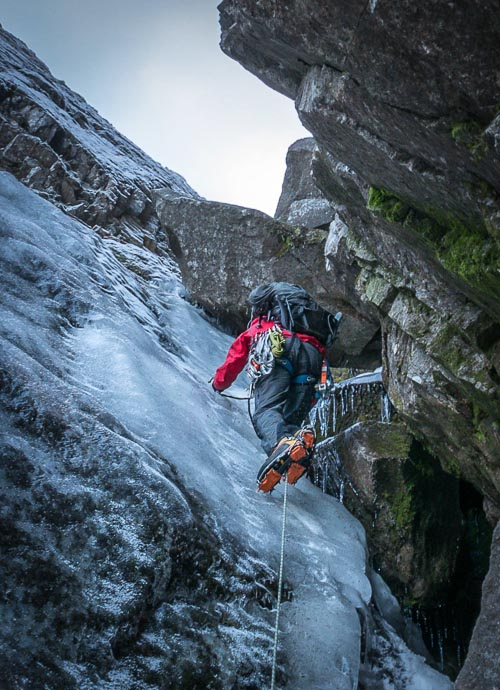 Gavin Mackenzie tip-toeing up thin ice on the first pitch of Raeburn's Gully on Lochnagar in early December. (Photo Adam Archibald)