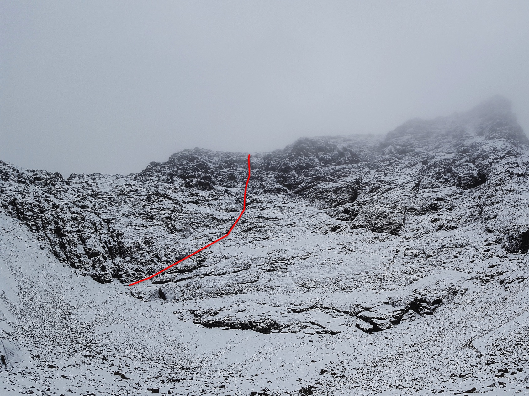 The line of Silver Fox (V,5) on the South Face of Sgurr Mhiccoinnich on Skye. This sustained five-pitch route follows a basalt dyke for most of its length. (Photo/Topo: Mike Lates)