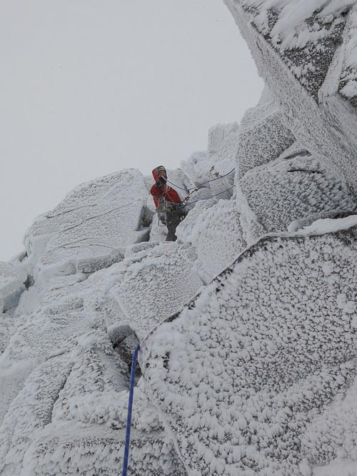 Roger Webb pulling the ropes through on the easy upper section of Shark (V,7) on Braeriach. High north facing aspects in the Cairngorms were well rimed on 2 January as a result of snowfall on New Years Day and strong north-westerly winds (Photo Simon Richardson)