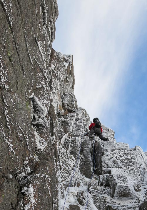 Roger Webb above the awkward squeeze-slot on a new III,5 in Coire an Lochain on Braeriach. Deep thaws and limited snowfall led to verglassed cracks on the steeper routes high in the Northern Corries, so the most enjoyable climbing was possibly on the lower-angled turfy mixed lines in the higher Cairngorms corries.