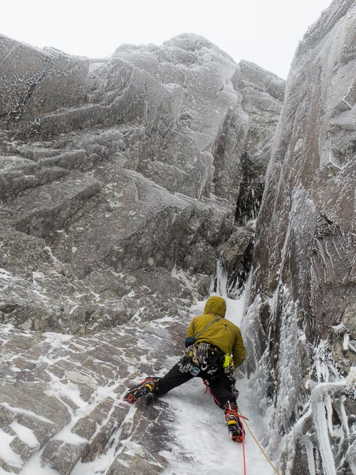 Brian Pollock leading the first pitch of Spartacus on South Trident Buttress on Ben Nevis. The link-up with the rarely climbed Devastation continues up the right-facing corner-crack directly above his head. (Photo Neil Adams)