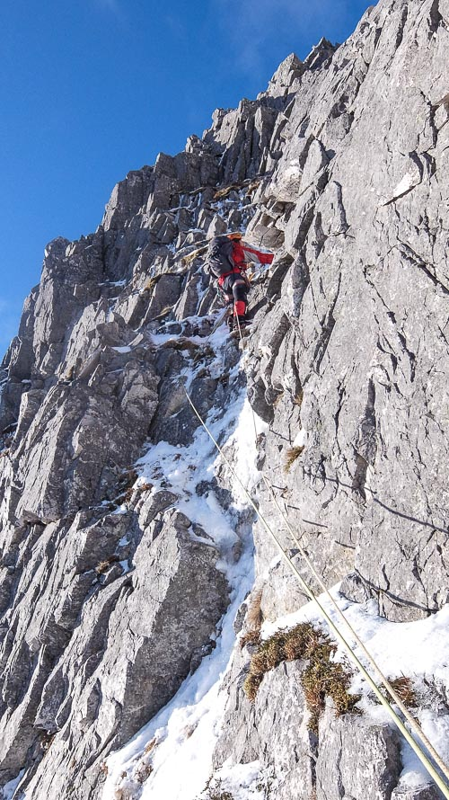 John Higham on the upper section of Tuadhan Rib (III,4) on the east flank of Beinn na Fhurain in Assynt in the far North-West. The rouge lies to the east of the ice lines of Fhurain Fall and Reign Fall that have a more northerly aspect. (Photo Iain Young)